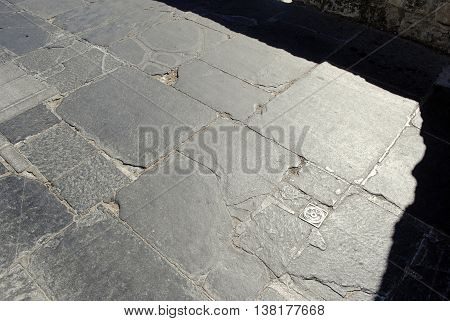 old granite paving  with an iron grip