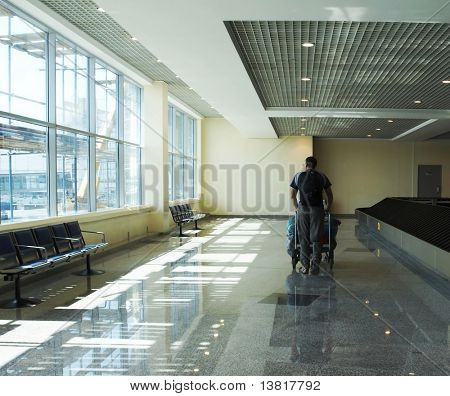 Man traveler walking the airport terminal