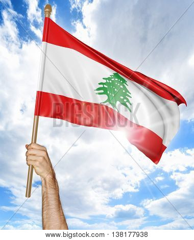 Person's hand holding the Lebanese national flag and waving it in the sky, 3D rendering