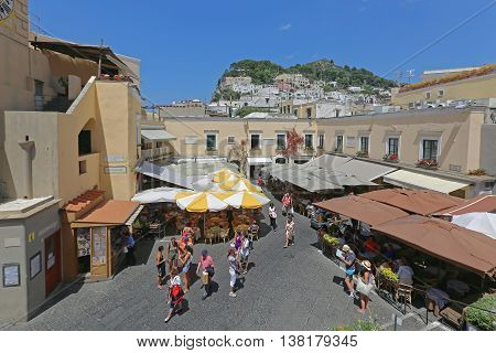 CAPRI ITALY - JUNE 26: La Piazzetta in Capri on JUNE 26 2014. Tourists at Square With Restaurants at Top of Island in Capri Italy.