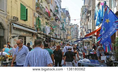 NAPLES ITALY - JUNE 22: Porta Nolana Market in Naples on JUNE 22 2014. Local People Shopping at Sunday Street Market in Napoli Italy.