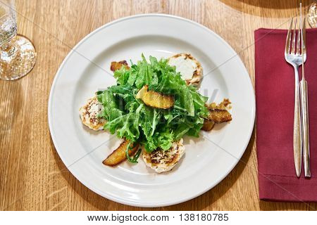 Salad With Arugula With Fried Cheese And Orange Slices