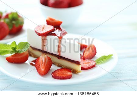 Strawberry Cheesecake On Plate On Blue Wooden Table