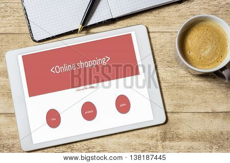 website creation on tablet lying on wooden table
