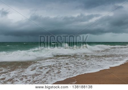 The landscape with cloudy sky and stormy sea