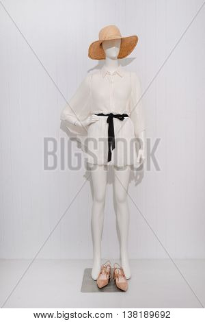 Full length female dress with hat on dummy