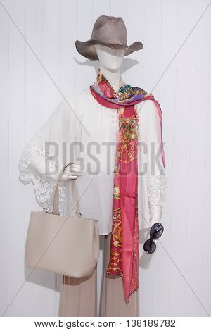 women dress with sunglasses ,scarf ,bag on dummy