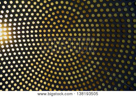 Dotted background of the colorful circles, contrast yellow geometric pattern. Abstract modern design background. Photo of stained-glass windows in roof.