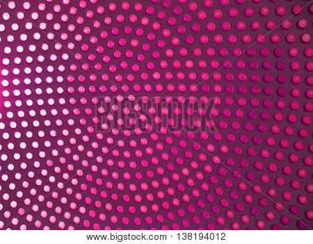 Dotted background of the colorful circles, magenta geometric pattern. Abstract modern design background. Photo of stained-glass windows in roof.