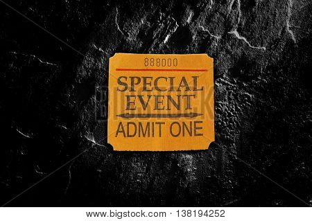 Special Event ticket stub in spotlight on textured background