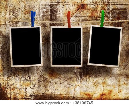 Film Blanks Hanging on a Rope Held By Clothespins on a Grunge Background