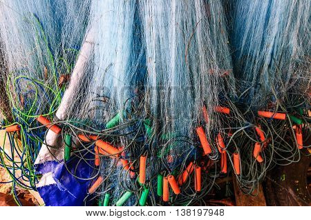 Hanging fishing nets with floats in Thailand