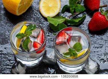 Mineral Water With Lemon, Strawberries And Mint. Summer Refreshment Drink. Detox