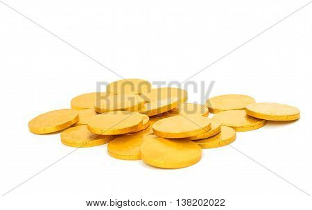 candy gold coins on a white background