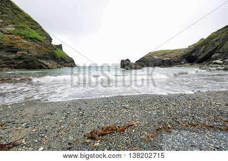 View out to sea with cliffs and seaweed
