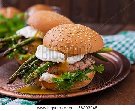 Hamburger (sandwich) With Chicken Burger, Lettuce, Asparagus, Poached Egg And Tartar Sauce
