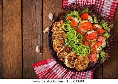 Dish With A Snack Of Fried Zucchini With Tomatoes And Succulent Chicken Cutlets With Zucchini. Top V