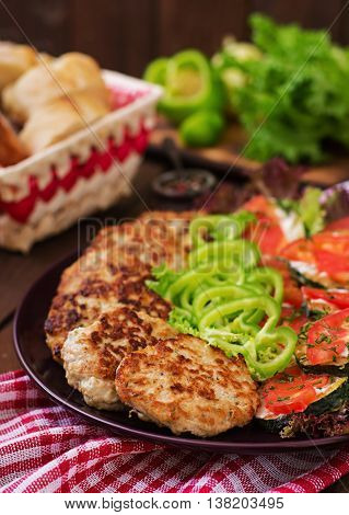 Dish With A Snack Of Fried Zucchini With Tomatoes And Succulent Chicken Cutlets With Zucchini.