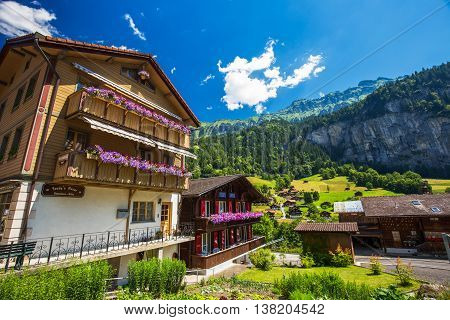 Lauterbrunnen, Switzerland - May 2016- Famous Lauterbrunnen Valley With Gorgeous Waterfall And Swiss