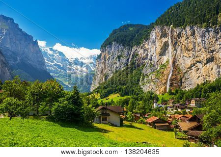 Famous Lauterbrunnen Valley With Gorgeous Waterfall And Swiss Alps In The Background, Berner Oberlan