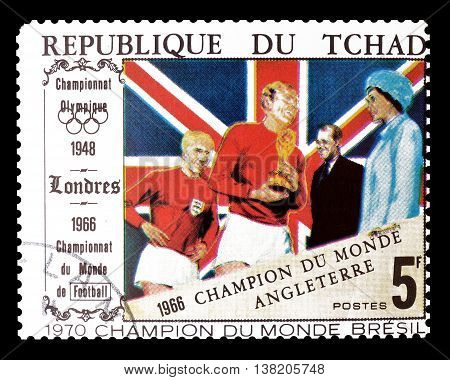 CHAD - CIRCA 1970 : Cancelled postage stamp printed by Chad, that shows football players, Queen and Great Britain flag.