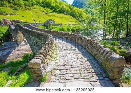 Double arch stone bridge at Ponte dei Salti with waterfall Lavertezzo Verzascatal Canton Tessin.