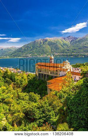 Madonna del Sasso Church above Locarno city lake Maggiore (Lago Maggiore) and Swiss Alps in Ticino Switzerland.