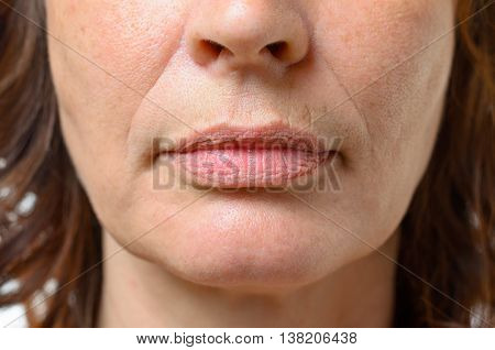 Closeup On The Mouth Of A Middle-aged Woman