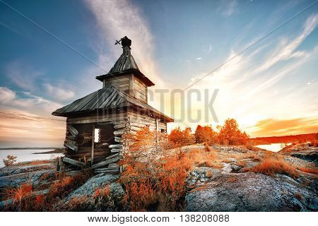 Old wooden church on a stone island
