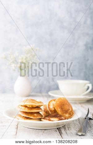 Dutch mini pancakes called poffertjes. Healthy food concept with copy space.