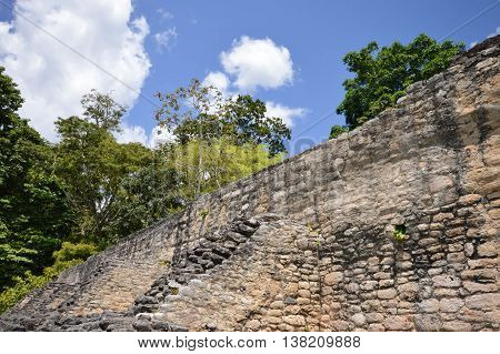 Close up of the front wall of Caana pyramid at the Caracol archaeological site of Maya civilization in Belize