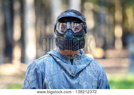 Closeup of young man in paintball mask