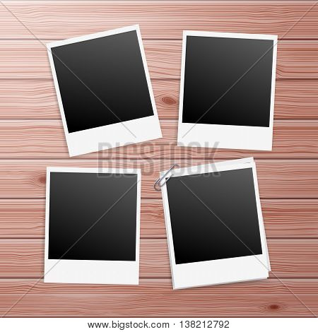 Photo Frames on Wooden Background with Paperclip
