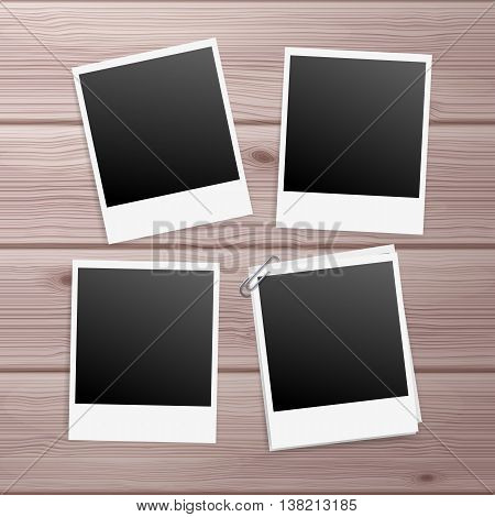 Retro Photo Frames on Wooden Background with Paperclip