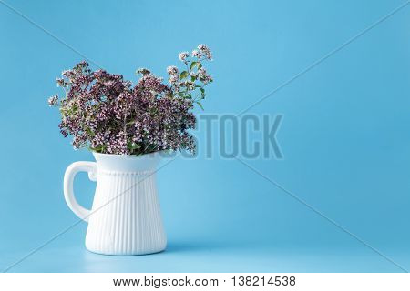 Vintage Vase With A Bouquet Of Blossoming Oregano
