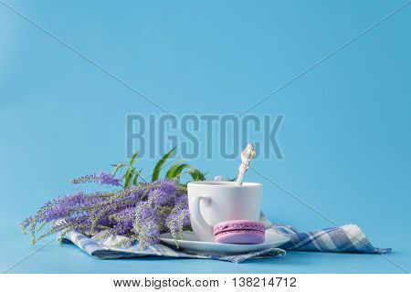 A Cup Of Morning Americano Coffee With French Macarons On  Blue Background