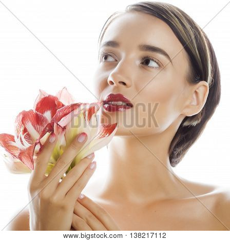 young pretty brunette woman with red flower amaryllis close up isolated on white background. Fancy fashion makeup, bright lipstick, creative Ombre manicured nails. spa skin care makeup