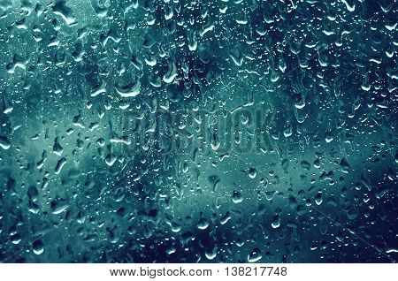 Rainy wet cold blue eco seasonal natural background with water drops
