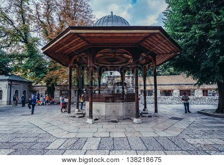 Sarajevo Bosnia and Herzegovina - August 23 2015. Shadirvan Fountain in front of 16th century Ottoman style Gazi Husrev-beg Mosque located at Bascarsija area in Sarajevo