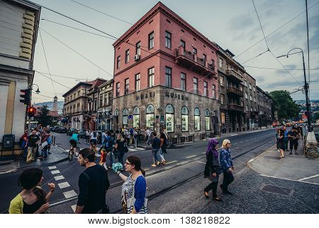 Sarajevo Bosnia and Herzegovina - August 23 2015. People walks in front of place of Assassination of Archduke Franz Ferdinand of Austria