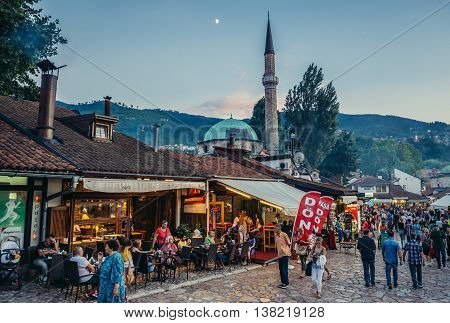 Sarajevo Bosnia and Herzegovina - August 24 2015. Tourists and local residents walks at main square of Bascarsija area in Sarajevo