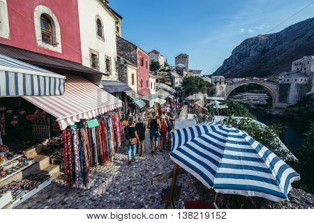Mostar Bosnia and Herzegovina - August 25 2015. Souvenir shops on the Old Town of Mostar. View with Old Bridge on background