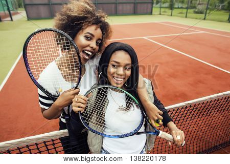 young pretty girlfriends hanging on tennis court, fashion stylish dressed swag, best friends happy smiling together, lifestyle real people concept