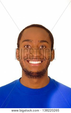 Headshot handsome man wearing strong blue colored t-shirt smiling to camera, white studio background.