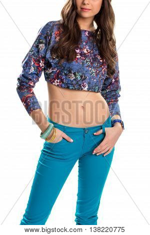 Young lady in crop top. Blue trousers and printed top. Stretch pants of high quality. Always stay in the trend.