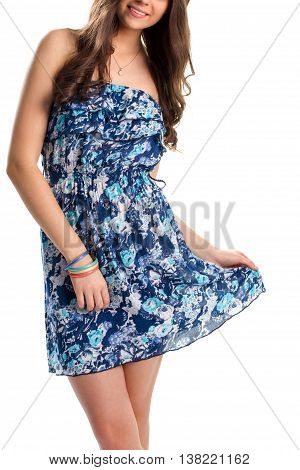 Woman in blue floral dress. Colorful bracelets and necklace. High quality summer apparel. Light garment with flower print.