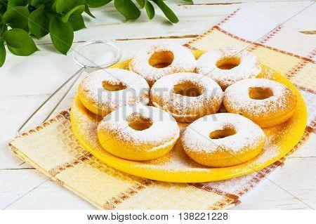 Homemade Hanukkah donuts with caster sugar. Hanukkah sweet donuts. Sweet dessert pastry doughnuts.