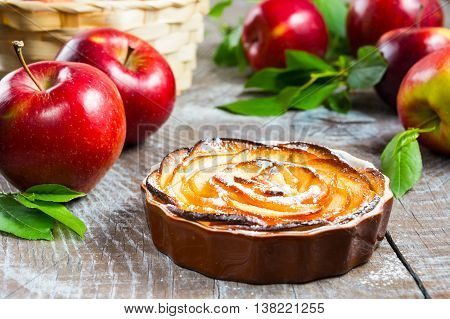 Puff apple shaped roses pie. Homemade sweet apple dessert pie. Homemade apple rose pastry.