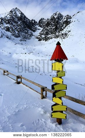 information point and wooden fence in winter mountains