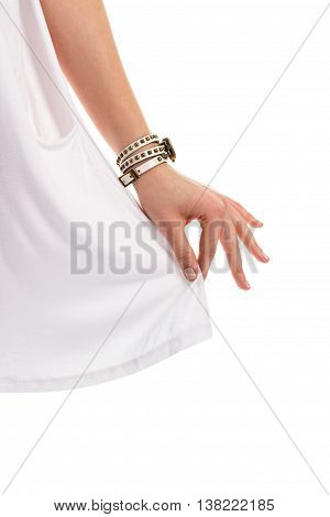 Small watch on lady's hand. Fingers touching white fabric. Trendy watch with strap. Soft high-quality cotton.